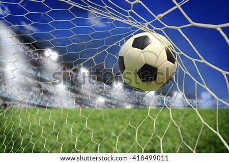 soccer ball in goal with spotlight