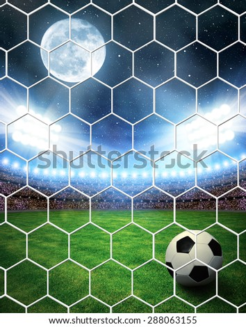"Soccer ball in grass, soccer stadium with the dright lights. ""Elements of this image furnished by NASA"". - stock photo"