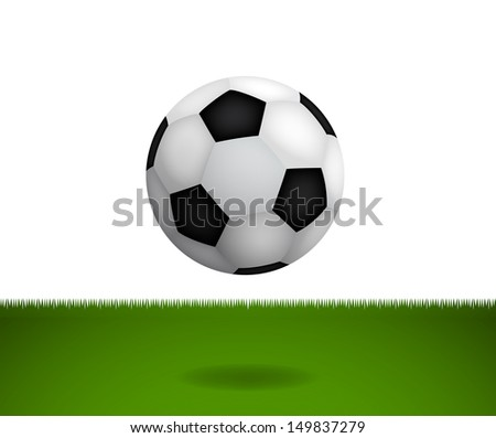 Soccer ball in green field
