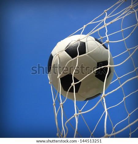 soccer ball in net - stock photo