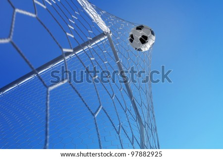 Soccer ball in net on blue sky background. Goal. - stock photo