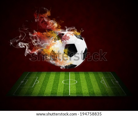 Soccer ball in the color of flame and smoke. Sport concept - stock photo