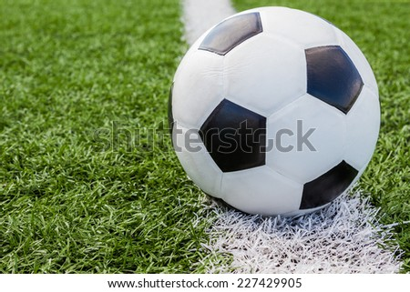 soccer ball in the field on the white line background - stock photo