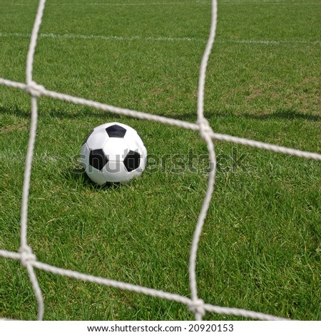 Soccer ball in the goal net. See more soccer images in my portfolio.