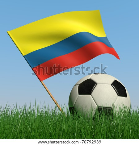 Soccer ball in the grass and the flag of Colombia against the blue sky. 3d - stock photo