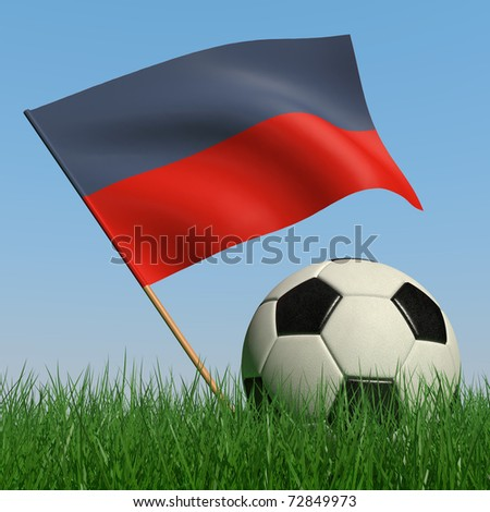 Soccer ball in the grass and the flag of Haiti against the blue sky. 3d - stock photo