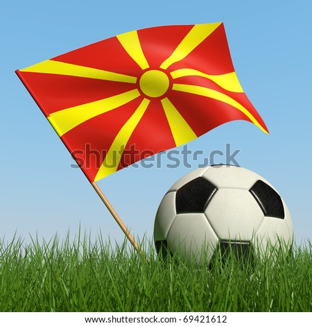 Soccer ball in the grass and the flag of Macedonia against the blue sky. 3d - stock photo