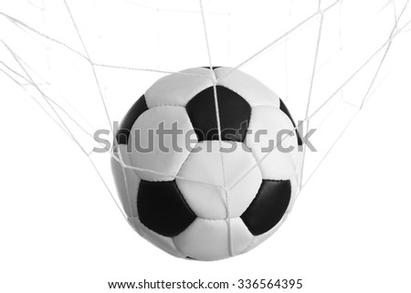 Soccer ball in the net isolated on white - stock photo