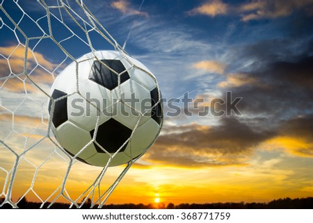 Soccer ball into Goal the target with Blue Sky - stock photo