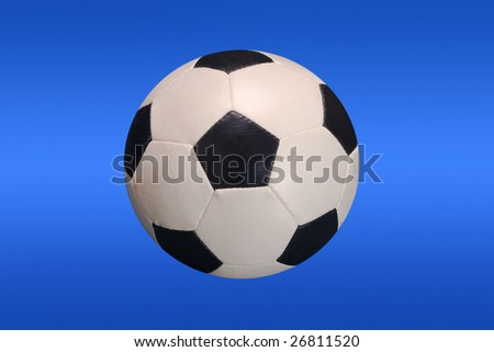 soccer ball isolated on blue - clipping path included - stock photo