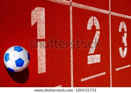 soccer ball  lies on  a racetrack - stock photo
