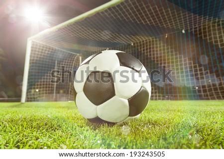 soccer ball near goal and lensflare - stock photo