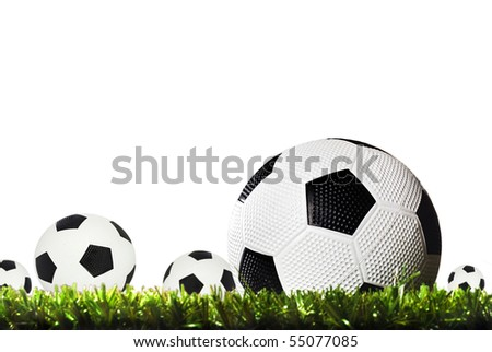 Soccer ball on a soccer field against a white background with space for text - stock photo
