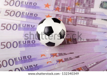 Soccer ball on background of euro banknotes. - stock photo