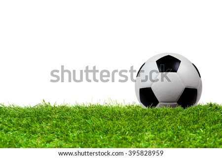 Soccer ball on grass isolated on white background - stock photo