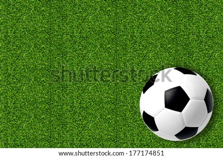 Soccer ball on green field grass