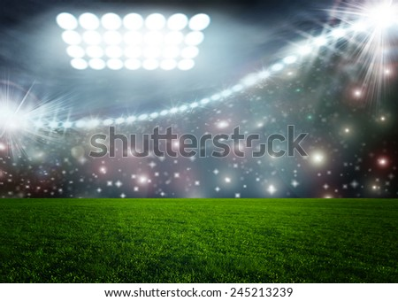 Soccer ball on green stadium arena - stock photo
