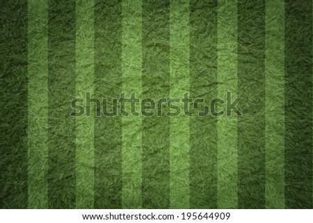 Soccer ball on green stadium, arena in night illuminated bright spotlights. - stock photo