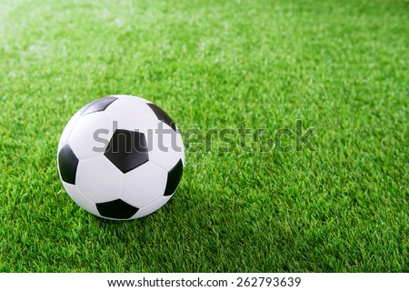 Soccer ball on green turf - stock photo