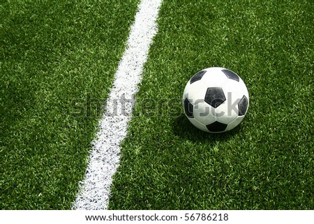 soccer ball on occer field have line - stock photo
