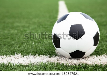 soccer ball on soccer field  - stock photo