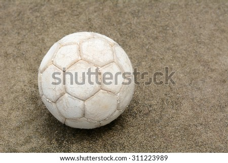 Soccer ball on the cement floor - stock photo