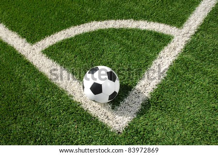 Soccer ball on the corner field - stock photo