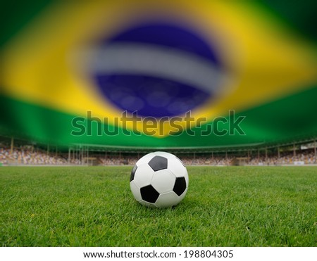 Soccer ball on the field of stadium on Brazil flag background - stock photo
