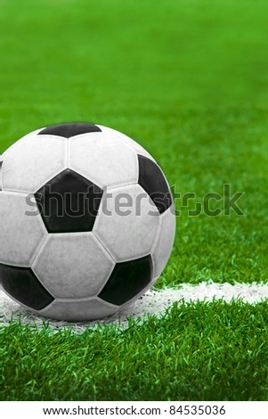 Soccer ball on the field - start match - stock photo