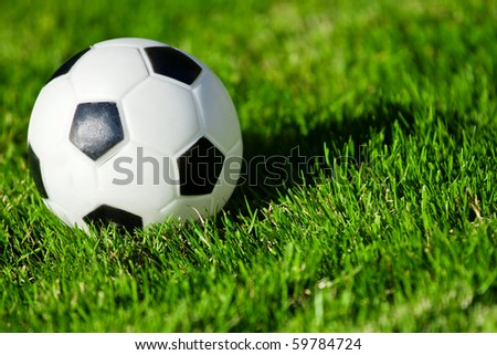 Soccer ball on the field with shadow - stock photo