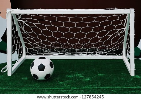 Soccer ball on the field with Soccer goal - stock photo