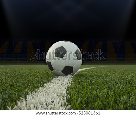 Soccer ball on the green field