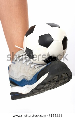 soccer ball on top of a rubber shoes