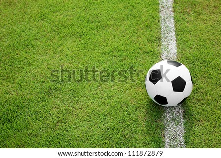 soccer ball on white line - stock photo