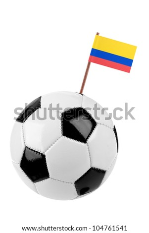 Soccer ball or football decorated with a small national flag of Colombia on a tooth stick - stock photo