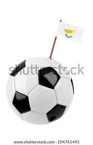 Soccer ball or football decorated with a small national flag of Cyprus  on a tooth stick - stock photo