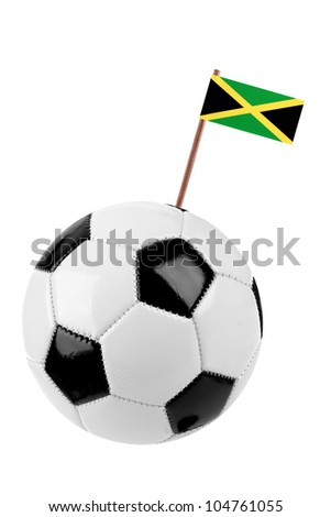 Soccer ball or football decorated with a small national flag of Jamaica on a tooth stick - stock photo