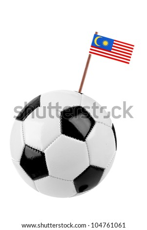 Soccer ball or football decorated with a small national flag of  Malaysia on a tooth stick - stock photo