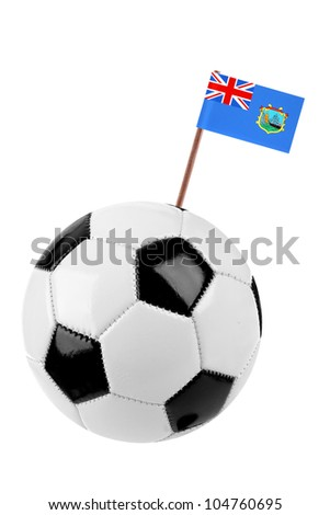 Soccer ball or football decorated with a small national flag of St. Helana on a tooth stick - stock photo