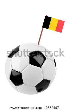 Soccer ball or football decorated with a small national flag on a tooth stick - stock photo