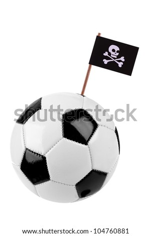 Soccer ball or football decorated with a small Pirate flag on a tooth stick - stock photo