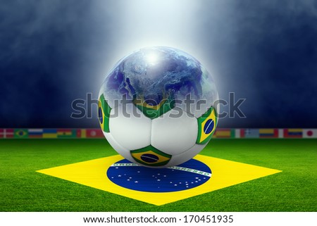 Soccer ball, planet earth globe, green soccer stadium, arena in night illuminated bright spotlights, flag of Brazil, brazil soccer, world sports event. Elements of this image furnished by NASA - stock photo