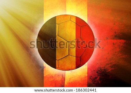 Soccer ball with Belgian flag as the background - stock photo