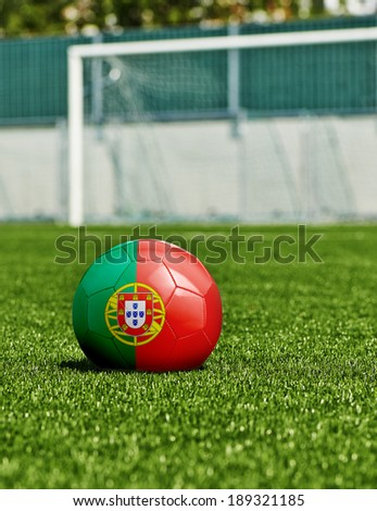 Soccer Ball with Portugal Flag on the grass in stadium