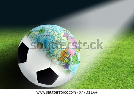 Soccer balls and globes created in photoshop - stock photo