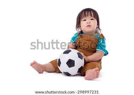 Soccer children sitting on a white background. - stock photo