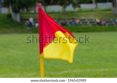 Soccer corner flag on the stadium - stock photo