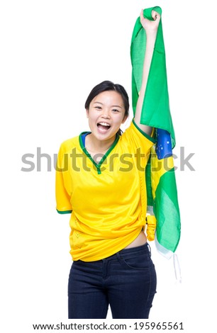 Soccer fans holding up Brazil flag
