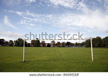 Soccer field and goal post in a local residential area - stock photo