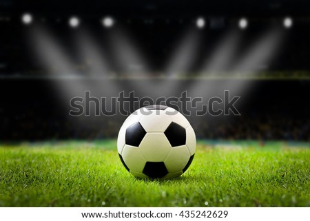 soccer field and stadium with fans the night light before the match, soccer stadium, soccer match, soccer on grass, soccer football, soccer team, soccer sport,soccer at night, soccer arena. - stock photo